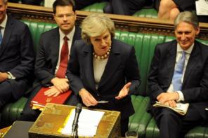 Britain's Prime Minister, Theresa May, addresses the House of Commons during her first Prime Minister's Questions in London
